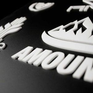 Laser Cut White Acrylic Lettering On Black Acrylic Background